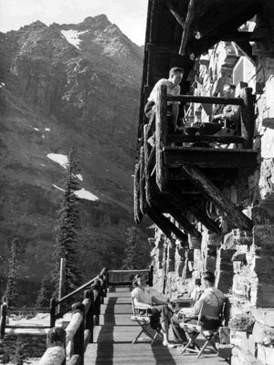 Tourists on balcony of Sperry Chalet, circa 1940