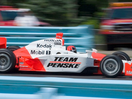 Helio Castroneves drives through Turn 1 during IndyCar