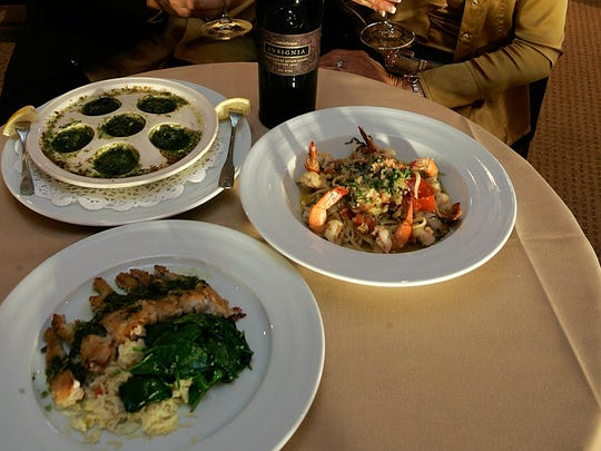 Kevin and Dodi Henry show off a selection of their dishes including, clockwise from bottom, Frog Legs a La Provencal, Shrimp Scampi and the Escargot in 2010