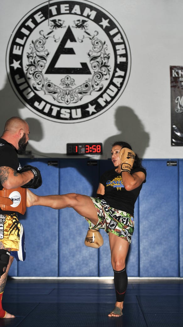 UFC fighter Marion Reneau trains with coach Doug Marshall