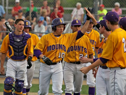 Ephrata's Nate Fassnacht (10) is congratulated by teammates after smacking a 3 run home run against Hempfield during 6th inning action at Ephrata War Memorial Field Tuesday May 12, 2015. Chris Knight - GametimePa.com