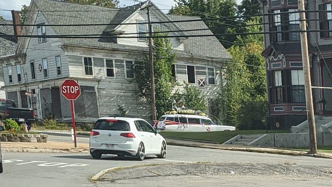 """The iconic Ghostbusters Ectomobile was spotted driving around near the S.K. Pierce """"haunted"""" mansion (shown at right) in South Gardner on Monday, Aug. 31."""