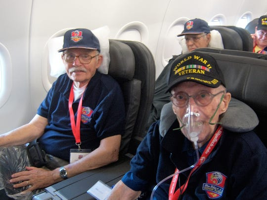 At left, Army veteran Donaldson Woods recently flew on the first Honor Flight for Korean War veterans.