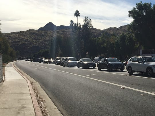 Northbound traffic is backed up on Gene Autry Trail following a collision involving a Mazda and gardening truck. The Mazda's driver suffered serious injuries but was expected to survive.