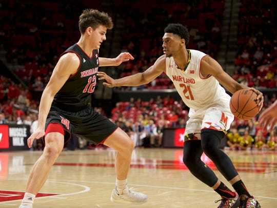 Iowa State's Michael Jacobson, left, defends Maryland's Justin Jackson during his Cornhusker days.