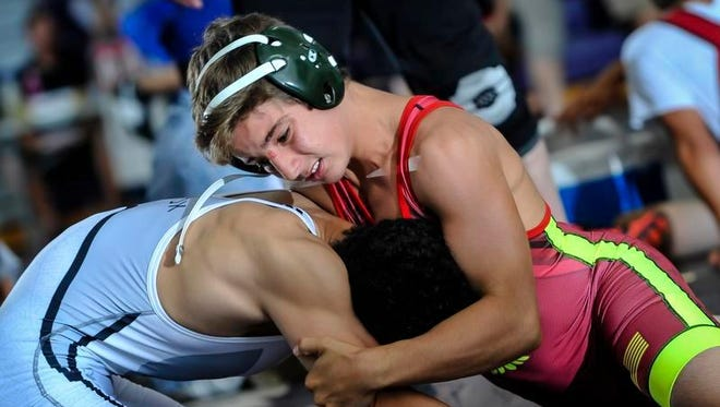 South Plainfield's Jake Giordano (left) works to score points against South Brunswick's Sean Lubiak during their 126-pound match during the Old Bridge Summer Wrestling Duals at Old Bridge High School in Matawan on July 11, 2016.