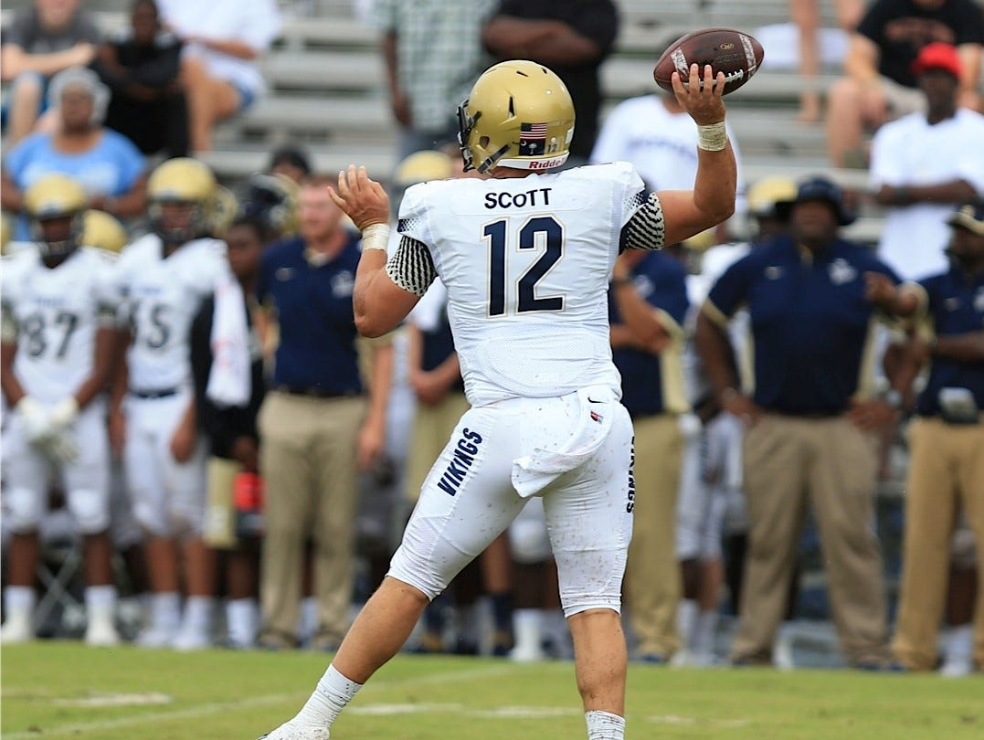 Spartanburg quarterback Austin Scott delivers one of many passes during a game against Wakulla on Saturday.