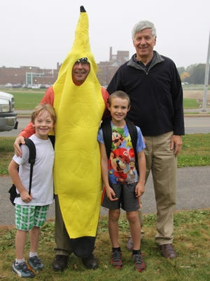 2014 International Walk to School Day in Brockport. From left, Brady Putnam, Scott Morrison (Barclay School principal), Will Hawken and Dr. James Goetz (founder of the event in Brockport). photo by Caurie Putnam