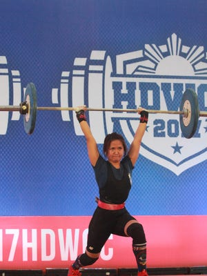 Armie Almazan, who lifts in the 75-kilogram class, completes a lift of 58 kg (127 pounds) in the snatch, at a recent weightlifting tournament held in the Philippines. Almazan captured the bronze medal at that event, the Hidilyn Diaz Weightlifting Open Championship held July 8-9.
