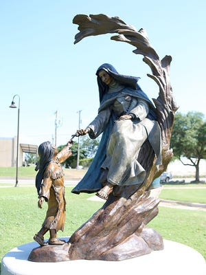 The Lady in Blue bronze statues, which were set up in May, are displayed along the Concho River in downtown San Angelo Friday, June 8, 2018.
