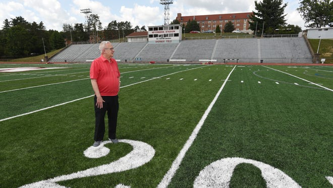 Ron Vessels stands on the Muskingum University football field at McConagha Stadium. Vessels hasn't missed a John Glenn High School football game since the 1950s, and a home Muskingum University football game in nearly as long.