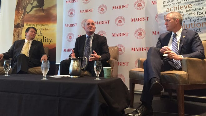 """Hudson Valley Pattern for Progress President and CEO Jonathan Drapkin makes a point while moderating """"Across The Aisle"""" at Marist College Friday. In the photo, Rep. John Faso, R-Kinderhook, is at left. Rep. Sean Patrick Maloney, D-Cold Spring, is at right."""