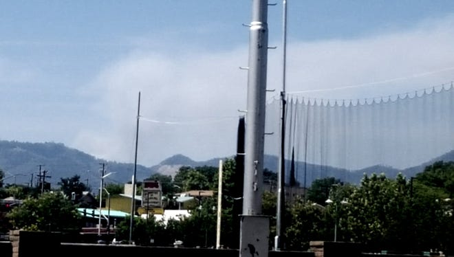 Smoke rises Friday afternoon from the Highland Fire that's burning about 60 acres in the French Gulch area.