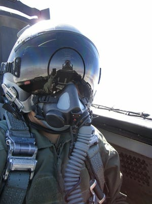 Toni Cooper in an F-15 Eagle over Utah. Served in the Air Force from 2007-2015. She lives in Cocoa.
