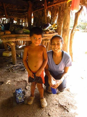 Iowa City native Claudia Garcia, right, smiles with one of the children she met as a Peace Corps volunteer in Panama from 2012-14.