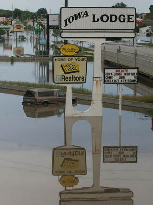 Rising floodwaters surround the Iowa Lodge on the Coraville Strip on Friday, June 13, 2008.