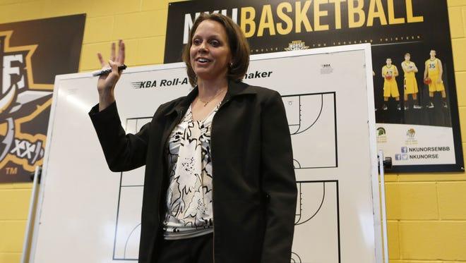 NKU coach Dawn Plitzuweit gives a pregame talk in 2013.