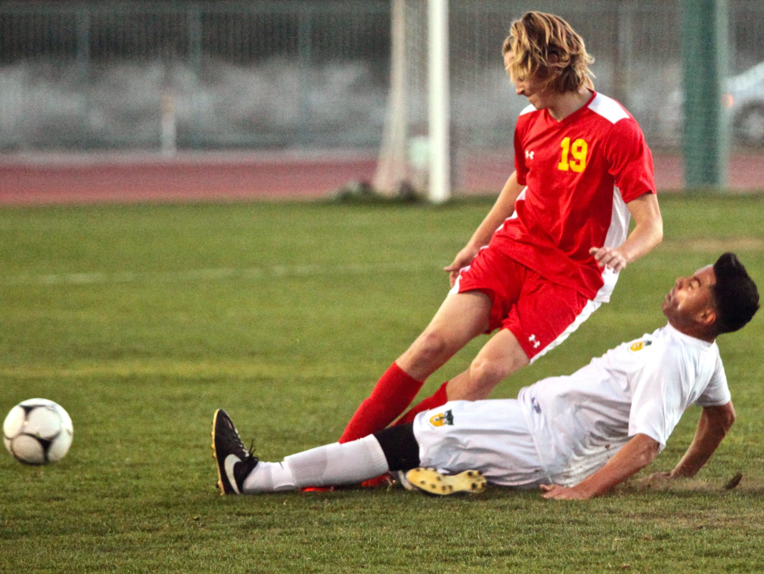 Coachella Valley's Jose Castanos (9) tackles Palm Desert's Gavin Kirk (19) during a match in Thermal on Tuesday.