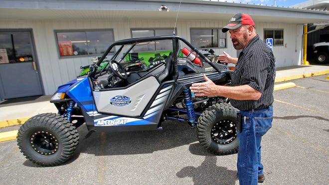Darryl Dunlap, owner of Dunlap Performance and Motorsports in Farmington, talks on April 28 about how to modify an off-highway vehicle to make it legal to drive on Farmington's streets.