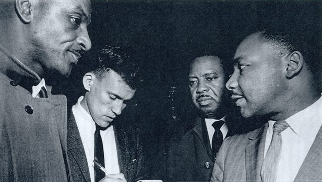 A young Jim Purks of the Associated Press interviews the Rev. Fred Shuttlesworth, left, Ralph David Abernathy and the Rev. Martin Luther King Jr. in 1963.