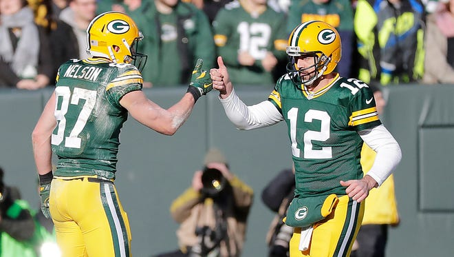 Green Bay Packers wide receiver Jordy Nelson (87) and quarterback Aaron Rodgers (12) celebrate a touchdown completion in the second quarter against the Minnesota Vikings at Lambeau Field Saturday, December 24, 2016.