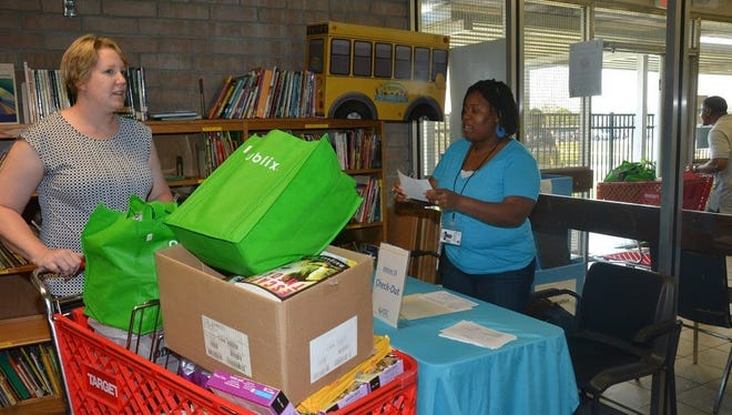 Brevard County teachers shop at Supply Zone for Teachers in Cocoa. The store allows teachers to select free supplies they need for their classroom and also give items to students who come the first day without supplies.