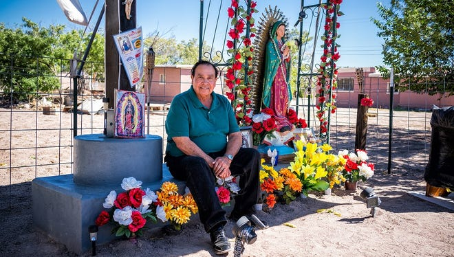 """City Councilman Joe """"Butter"""" Milo sits by a memorial to lost immigrants he built in Deming, on Oct. 2, 2017. Milo's parents were first-generation immigrants from Mexico."""