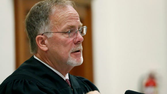 Special Judge Hollis McGehee speaks to attorneys during a status conference Wednesday, Aug. 20, 2014, in the Circuit Court Courtroom of the Jones County Courthouse in Laurel, Miss., regarding the lawsuit by State Sen. Chris McDaniel, R-Ellisville, to overturn results of a Republican primary for U.S. Senate. McDaniel filed the lawsuit last week, challenging his loss to six-term Sen. Thad Cochran in the June 24 GOP primary.
