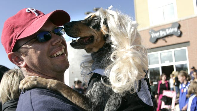 wdm1031dogs----Rob Mulaney, of Des Moines' west side, holds his dog Shadow who was dress as a Playboy Playmate during the costume contest at the Dogtoberfest at Three Dog Bakery in West Des Moines Saturday October 25, 2008. (Lisa Fernandez/The Register)