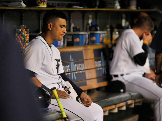 Jose Iglesias sits by himself in the dugout after his spat with James McCann in a game against the Red Sox last August.