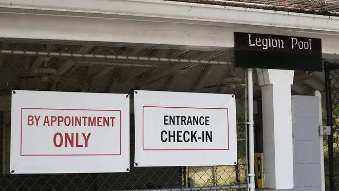 Signs mark the entrance to the University of Georgia's COVID-19 testing site at Legion Pool on campus.