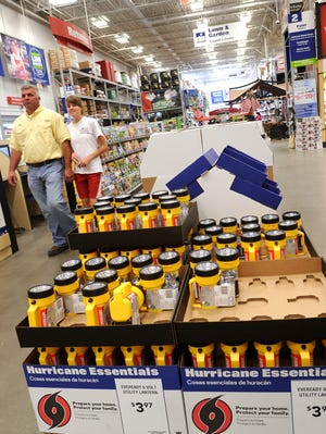 Stock up on storm necessities like water, non-perishable foods, batteries and flashlights now.