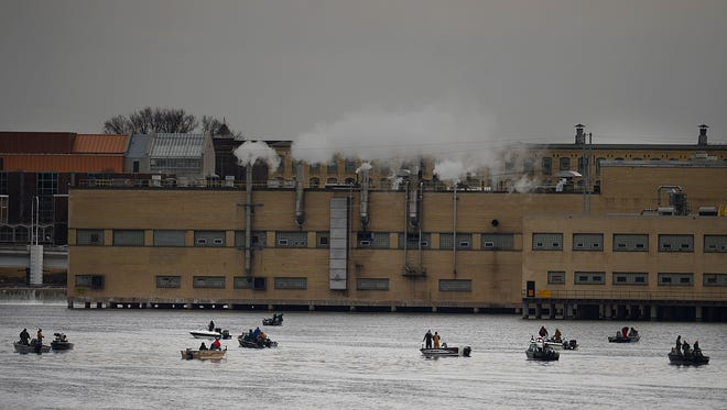 Anglers try they luck on the Fox River in De Pere on Thursday.