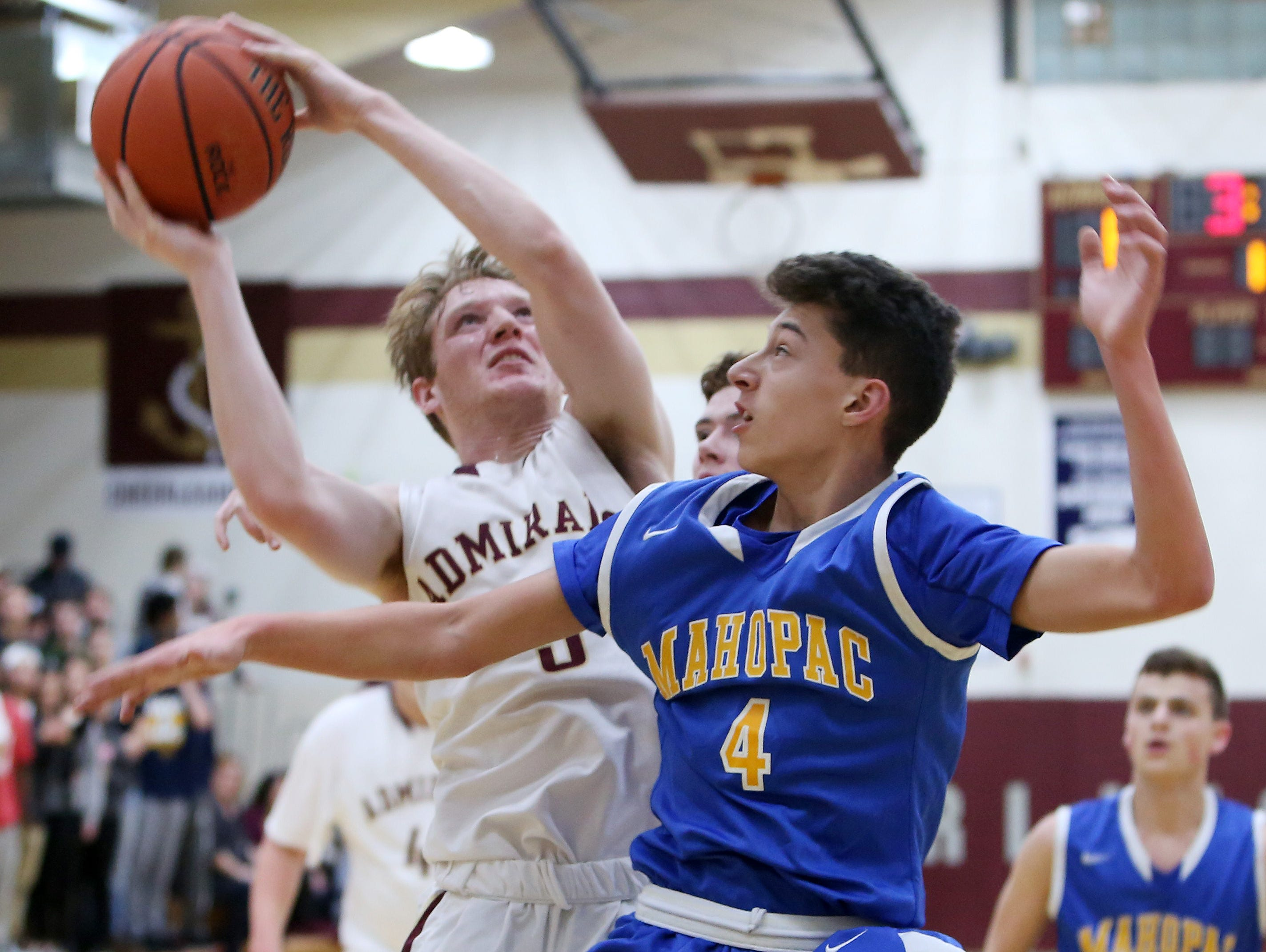 Arlington's John Smith (5) goes up for a shot in front of Mahopac's Zack Puckhaber (4) during a boys basketball game at Arlington High School Jan. 12, 2017.