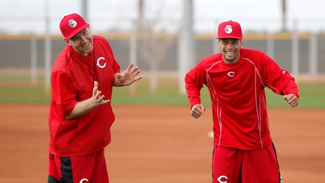 Reds third baseman Todd Frazier, left, and center fielder Billy Hamilton enjoy a laugh with new Red Marlon Byrd (not pictured) on Monday.