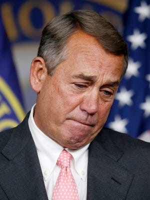 House Speaker John Boehner pauses during Friday's news conference on Capitol Hill.