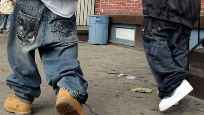 Leaders of an Alabama city fed up with sagging pants on young men and hemlines on women's skirts creeping higher are mulling penalties for clothing they consider inappropriate.
