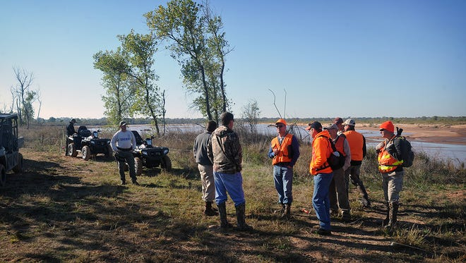 A survey crew from the Bureau of Land Management, accompanied by an attorney and two federal agents, were allowed onto Kevin Hunter's property, accompanied by two Wichita County Sheriff deputies and a second attorney Monday morning. The group is following a federal district judge's court order to survey the land to help determine the gradient boundary of the Red River and the property line of Hunter's land.