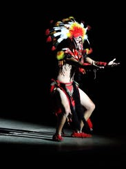 A performer dances during the Viva! El Paso show July