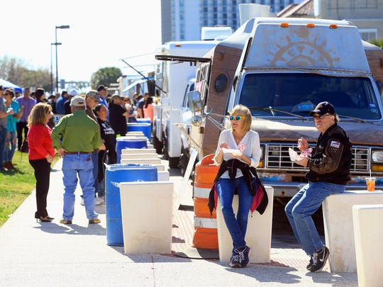 GABE HERNANDEZ/CALLER-TIMESCustomers stand in line as they prepare to order during the Food Truck Fridays on Friday, Jan. 29, 2016, at the North Bayfront Park  in Corpus Christi. People had the chance to enjoy the weather, play games and listen to live music.