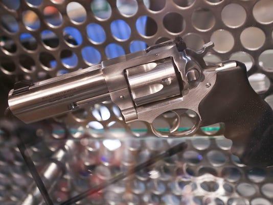 635876029673265871-GunControl-Handguns.jpg