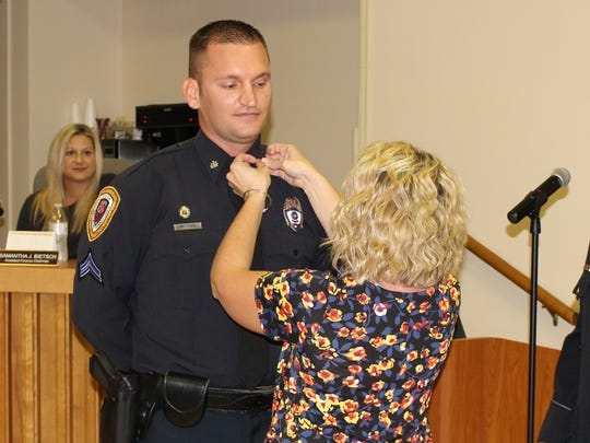 New Corporal Joe McGhee receives his pin Monday night. Chambersburg Police promoted 7 officers during the ceremony.