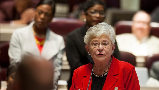 Governor Kay Ivey speaks after Lincoln Police Officer Zack Tutten is presented with the Legislative Medal of Honor for Law Enforcement before a joint session of the legislature on the house floor at the Alabama Statehouse in Montgomery, Ala. on Thursday April 20, 2017.