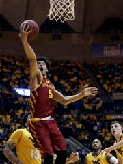 Iowa State guard Lindell Wigginton (5) drives during the Cyclones' game against West Virginia on Saturday, Feb. 24, 2018, in Morgantown, West Virginia.