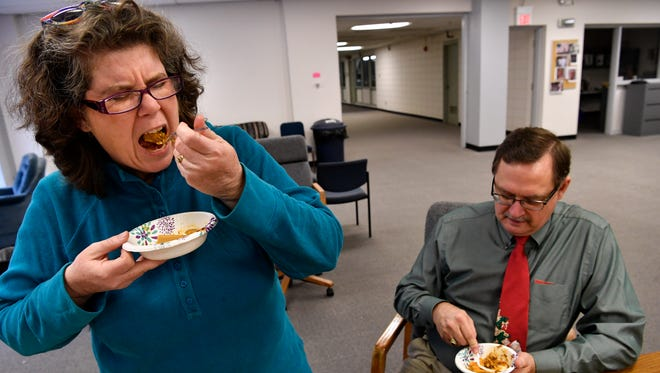 Anticipating the taste, Laura Gutschke grimaces as she takes a forkful of canned beef tamales Friday. The Reporter-News Shuck-off measured the quality of available tamales when you've got nowhere to turn.
