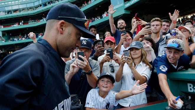 Derek Jeter leaves the field after the last baseball game of his career, at Fenway Park.
