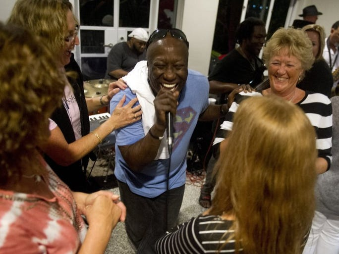 "Cindy Allen (back right) of Stuart dances with her friends to Harold Seay (center) and The Boogie Shoes Band Saturday night at the Mansion at Tuckahoe in Jensen Beach. The Friends of Mount Elizabeth hosted ""Get Down Tonight: A Tribute to KC and The Sunshine Band"" in an effort to bring music to the area and the outdoor amphitheater.  Rain forced the music inside the Mansion. Seay played drums for KC and the Sunshine Band."