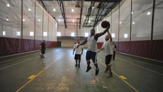 A group plays basketball during the Super Saturday event at Earlham College's Athletics and Wellness Center.