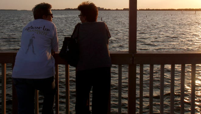 Laurie and Pearl Taylor talk on the Cape Coral Yacht Club pier June 5. In January Laurie was sent a vulgar video by a male co-worker.