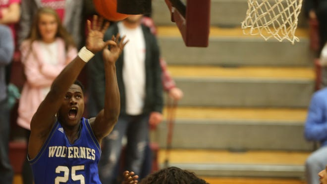 La Vergne's Maleik Gray goes up for a shot over Riverdale defenders in Tuesday night's District 7-AAA contest.